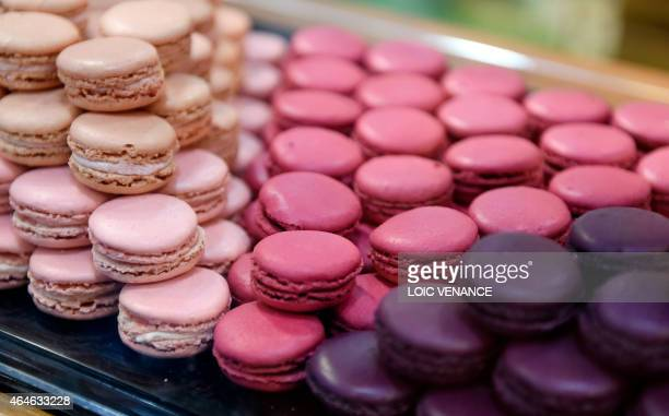 A picture taken on February 26 2015 shows 'Macarons' French pastries during the Paris international agricultural fair at the Porte de Versailles...