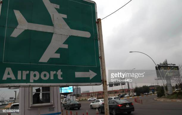 A picture taken on February 26 2018 shows a road sign to Arbil's International airport in the capital of Iraq's autonomous northern Kurdish region...
