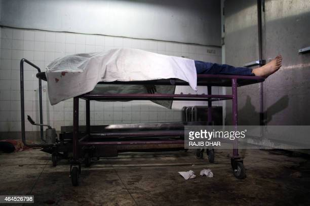 A picture taken on February 27 2015 shows the dead body of Avijit Roy a US blogger of Bangladeshi origin who was hacked to death at Dhaka Medical...