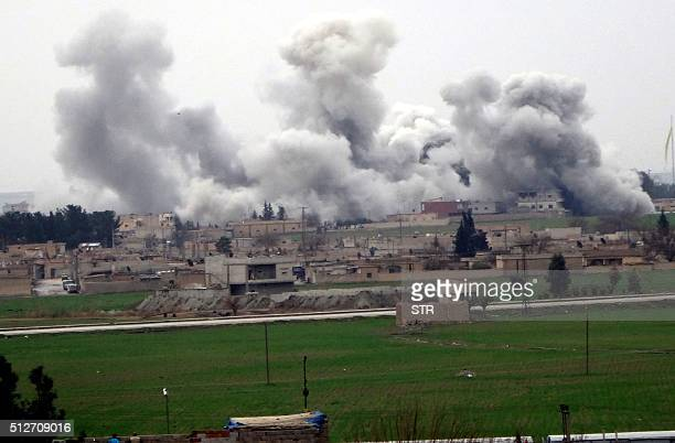 A picture taken on February 27 2016 in Akcakale in Sanliurfa province shows smoke rising from the neightbourhood of Syrian city Tel Abyad during...