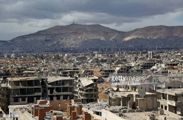 TOPSHOT A picture taken on February 27 2018 shows a view of the rebelheld neihgbourhood of Jobar on the eastern edge of the Syrian capital Damascus...