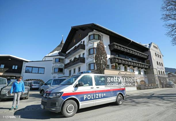 Picture taken on February 27 2019 shows a police car standing in front of the Austrian team's Hotel Bergland in Seefeld Austria where police raided...