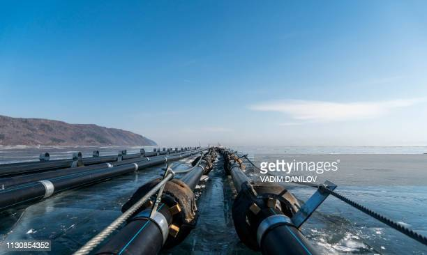 A picture taken on February 27 2019 shows water manifolds built on the ice of Baikal lake in the village of Kultuk A Chinafunded project to bottle...