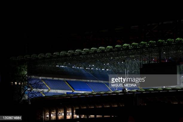 A picture taken on February 27 2020 shows the empty stands of the San Siro stadium closed to the public as a safety measure against the COVID19 the...