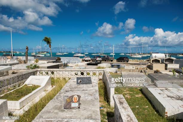 Picture taken on February 27 on the French overseas island of Saint-Martin, shows the cemetery of Marigot, which the wall is still broken after a...