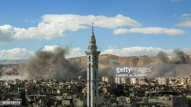 Picture taken on February 27 shows smoke plumes rising during reported regime bombardment Syrian rebel-held town of Douma, in the besieged Eastern...