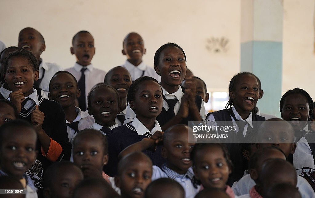 A picture taken on February 28, 2013 shows pupils reacting to feats of strength by Conrad Njeru Karukenya, 67, aka 'Tiger-power' at a presentation to pupils of the Tenri primary school in Kenya's central highlands county of Embu, which is also his place of birth. This living, breathing speed bump is a local legend and has a stomach that is strong enough to withstand a Land Rover running right over him, according to Discovery channel's Quest tv, hosted in the United Kingdom, which in May of last year hosted what has popularly been dubbed a 'superhuman showdown' that featured seemingly regular human beings with incredible abilities in a contest for the title of ultimate Superhuman. Divided into five unifying traits: speed, strength, endurance, brain power and skill five contestants push themselves to the limit in each episode, with Conrad placed second in the strength category, and among five finalists by internationally-acclaimed scientists Dr Heather Berlin, Dr Rahul Jandial and Professor Greg Whyte who will further select the two most impressive individuals to go head to head in the gruelling final showdown. From humble beginnings, the spiritual family man who loves eating organic food and whole grains and has never smoked or indulged in alchohol his entire life says,' I started doing these things as a joke while in school in 1963'. AFP PHOTO /Tony KARUMBA