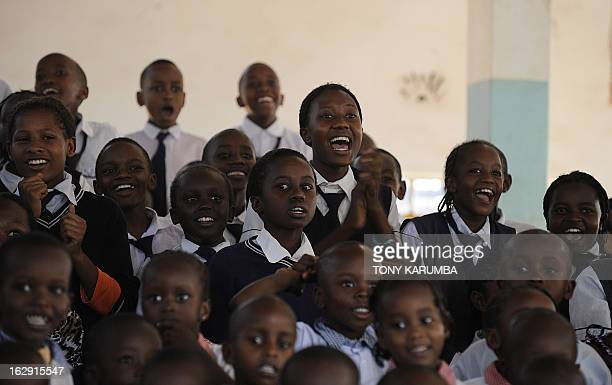 A picture taken on February 28 2013 shows pupils reacting to feats of strength by Conrad Njeru Karukenya aka 'Tigerpower' at a presentation to pupils...
