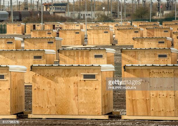 A picture taken on February 28 2016 shows a hut camp set by 'Medecins sans Frontiere' in GrandeSynthe near Dunkerque to shelter around 2000 Kurds...