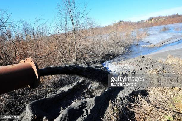 A picture taken on February 28 2017 shows ash being disposed outside Bosnia's largest coal burning electrical power plant near Tuzla in northeastern...