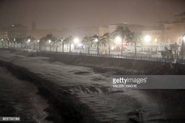 TOPSHOT A picture taken on February 28 2018 in Nice shows the beach and the Promenade des Anglais covered by snow / AFP PHOTO / VALERY HACHE