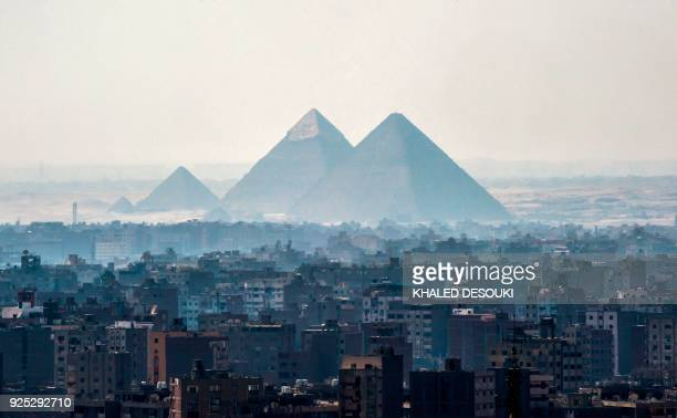 A picture taken on February 28 2018 shows a view of the Pyramids of Giza on the southwestern outskirts of the Egyptian capital Cairo / AFP PHOTO /...