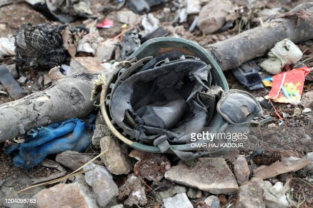 A picture taken on February 28 2020 shows a Turkish military helmet at the site of regime air strikes in the village of Balyun in Syria's...