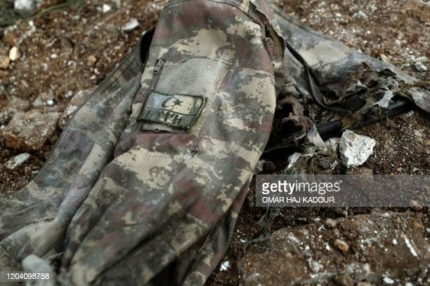 TOPSHOT A picture taken on February 28 2020 shows a Turkish military jacket at the site of regime air strikes in the village of Balyun in Syria's...