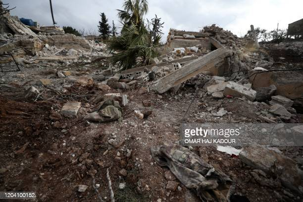 A picture taken on February 28 2020 shows a Turkish military jacket at the site of regime air strikes in the village of Balyun in Syria's...