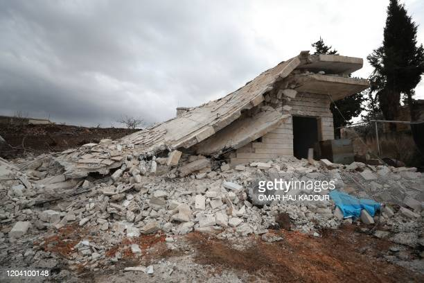 A picture taken on February 28 2020 shows destruction at the site of regime air strikes in the village of Balyun in Syria's northwestern Idlib...