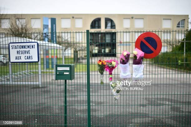 A picture taken on February 28 2020 shows flowers displayed at the entrance of the junior high school college Jean de La Fontaine in CrepyenValois...