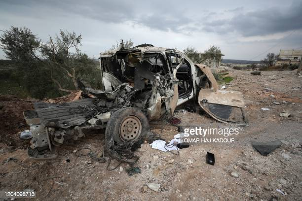 A picture taken on February 28 2020 shows the wreckage of a Turkish vehicle at the site of regime air strikes in the village of Balyun in Syria's...