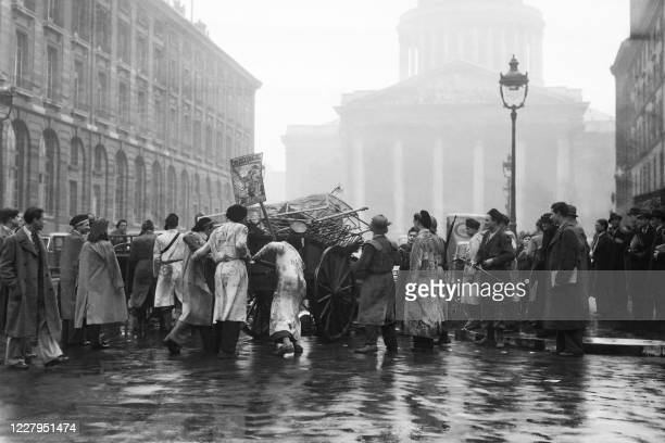 Picture taken on February 29, 1940 at Paris showing students carrying iron and wood's objects for the collecting aimed at the passive defence of the...