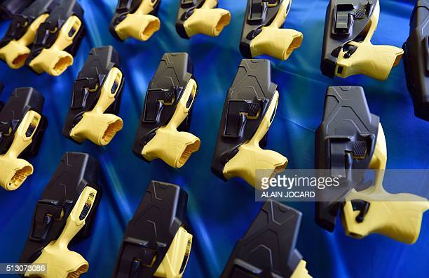 A picture taken on February 29 2016 in Paris shows taser guns during a presentation of the new equipment for the French anticrime brigade of the...