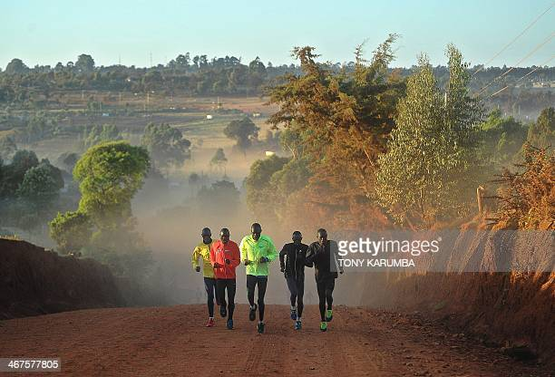 A picture taken on February 3 2014 shows athletes training in Kenya's renowned highaltitude village of Iten where professional runners from around...