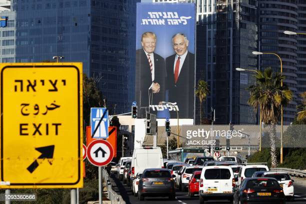 A picture taken on February 3 2019 in the Israeli coastal city of Tel Aviv shows a giant election billboard of Israeli Prime Minister Benjamin...