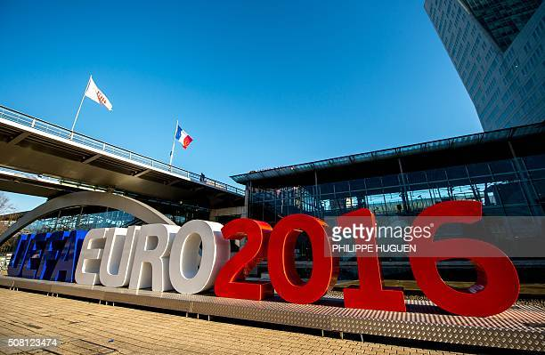 A picture taken on February 3 shows giant letters reading 'UEFA EURO 2016' in Lille northern France where some of the Euro 2016 football matches will...