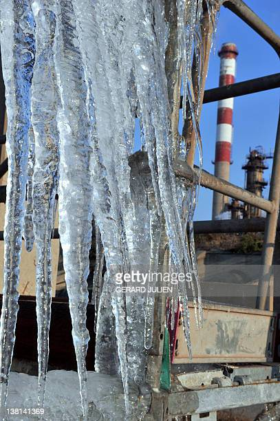 A picture taken on February 3 shows ice on a piece of metal at a petrochemical site in the southern French city of Martigues The French who have...