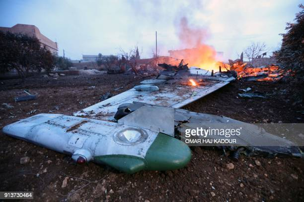 A picture taken on February 3 shows smoke billowing from the site of a downed Sukhoi25 fighter jet in Syria's northwest province of Idlib Rebel...