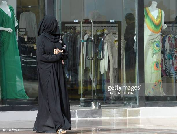 A picture taken on February 4 2013 shows a Saudi woman walking past a clothes store at a shopping mall in the Saudi capital of Riyadh AFP PHOTO/FAYEZ...