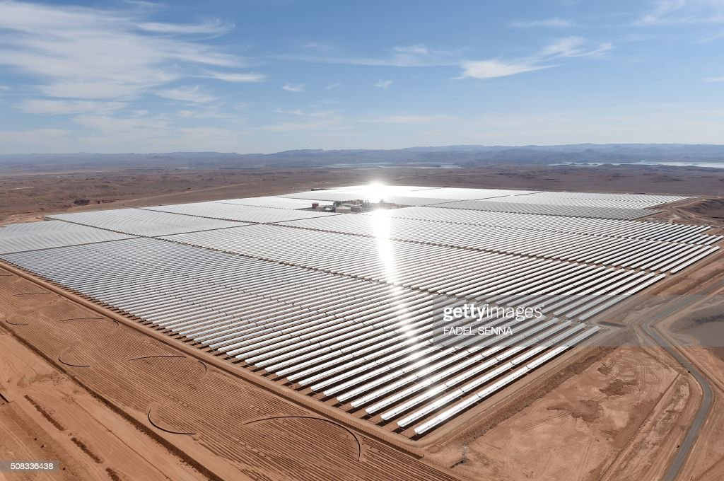 A picture taken on February 4, 2016 shows an aerial view of the solar mirrors at the Noor 1 Concentrated Solar Power (CSP) plant, some 20km (12.5 miles) outside the central Moroccan town of Ouarzazate, ahead of its inauguration. /