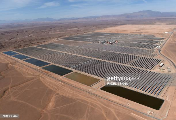 A picture taken on February 4 2016 shows an aerial view of the solar mirrors at the Noor 1 Concentrated Solar Power plant some 20km outside the...
