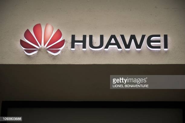 A picture taken on February 4 2019 shows the Huawei logo above the entrance of a Huawei store in Paris A government amendment to establish a...