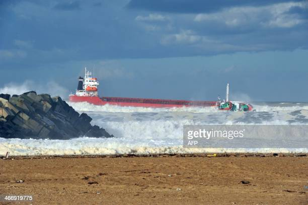 A picture taken on February 5 2014 shows a Spanish cargo ship ''Luno'' which slammed into a breakwater and split in two injuring at least one sailor...