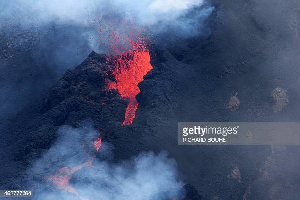 A picture taken on February 5 2015 shows Reunion Island's active volcano the Piton de la Fournaise erupting near the Dolomieu Bory and Rivals craters...