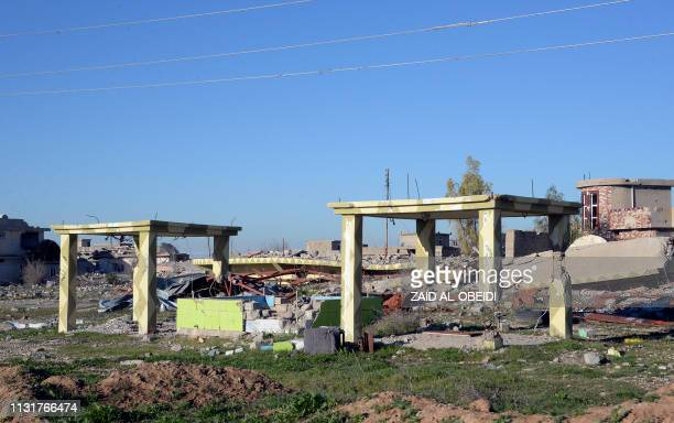 Picture taken on February 5 shows a general view of the damaged buildings in the northern Iraqi town of Sinjar. - For decades in the mountainous...