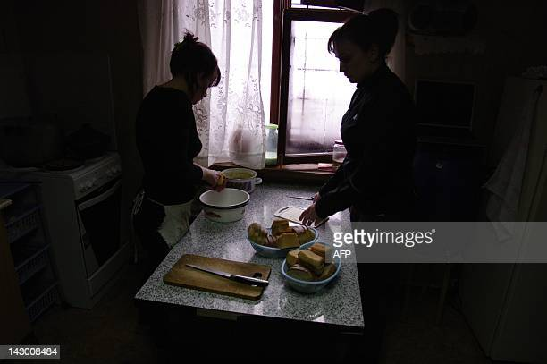 A picture taken on February 5 shows heroin addict girls dishing up at a rehab house in the Russian Urals city of Yekaterinburg Three dozen girls live...