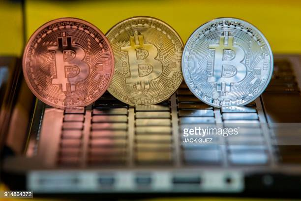 A picture taken on February 6 2018 shows a visual representation of the digital cryptocurrency Bitcoin at the 'Bitcoin Change' shop in the Israeli...