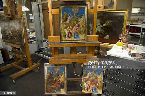 A picture taken on February 7 2013 shows the restored painting 'Oracion en el huerto' supposedly by painter Colart de Laon at El Prado museum in...