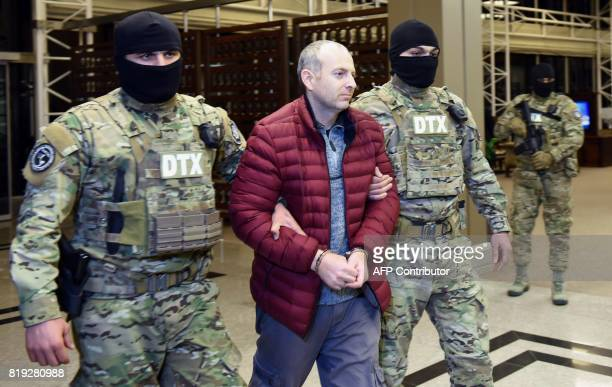 A picture taken on February 7 shows RussianIsraeli blogger Alexander Lapshin upon his landing in Baku after being extradicted from Belarus to...