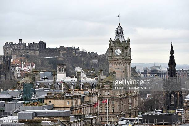 A picture taken on February 8 2010 in Edinburgh shows the castle of Edinburgh Balmoral's hotel building and the Scott Monument AFP PHOTO LIONEL...