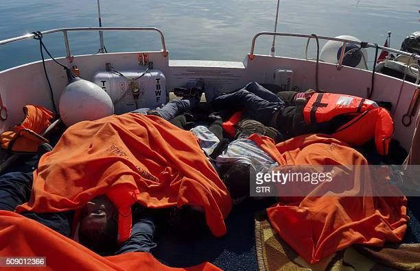 TOPSHOT A picture taken on February 8 2016 shows bodies of migrants on coast guard boat that docked in the Altinoluk district in Balikesir after they...