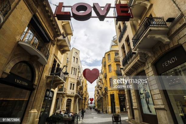 A picture taken on February 8 2018 shows hearts decorating a street in the centre of the Lebanese capital Beirut as the city prepares to celebrate St...