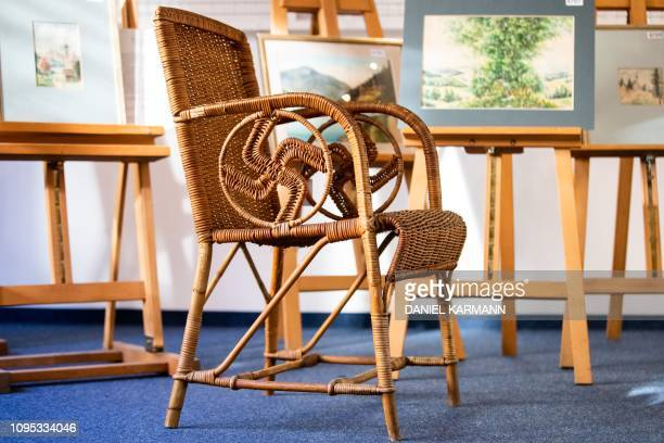 A picture taken on February 8 2019 at the Weidler auction house in the southern German city of Nuremberg shows a wicker armchair bearing a swastika...