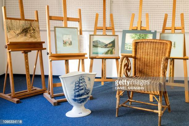 A picture taken on February 8 2019 at the Weidler auction house in the southern German city of Nuremberg shows a wicker armchair bearing a swastika a...