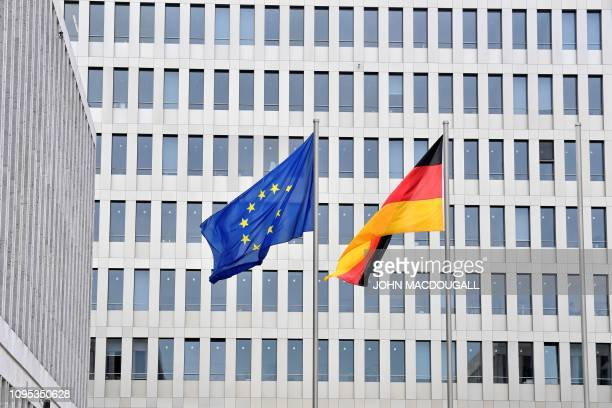 A picture taken on February 8 2019 in Berlin shows a German and a European flag fluttering in front of the Federal Intelligence Service headquarters...