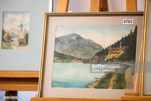 A picture taken on February 8 2019 shows the watercolour entitled Ortschaft an Vorgebirgssee a scene of a village near a mountain lake signed A...