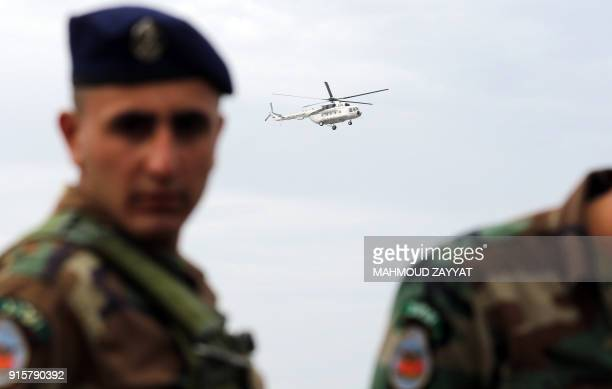 Picture taken on February 8 shows a UN peacekeeping force in Lebanon helicopter flies over Lebanon's southern border town of Naqura, as an Israeli...