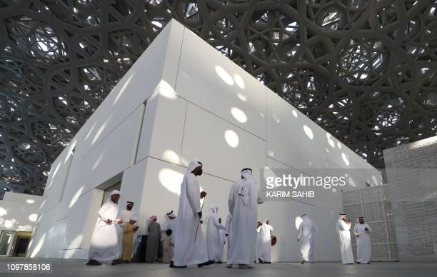 A picture taken on February 9 2019 shows visitors at the Louvre Abu Dhabi museum in the Emirati capital