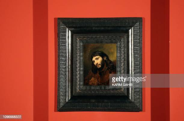 """Picture taken on February 9 shows a paining entitled """"Study of the head and clasped hands of a young man as Christ in prayer"""", oil on oak panel, by..."""